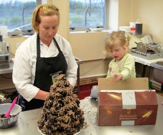 Sian and Isabel making a croquembouche