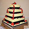 4 Tier Black & Ivory, Chocolate & Fruit Wedding Cake