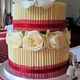 2 tier white cigarello wedding cake with roses