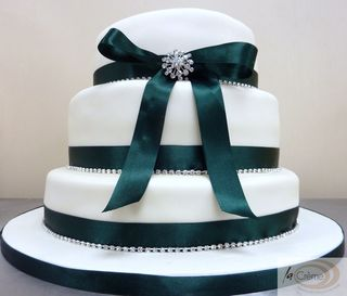 La Creme 3 tier ivory wedding cake with green ribbon and diamantes