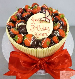 Chocolate cigarello birthday cake with dipped strawberries S