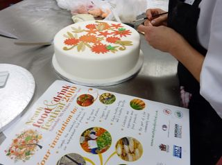 Mel making the Neath food festival cake
