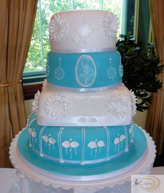 4 tier blue & white wedding cake