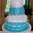4 tier blue & white wedding cake