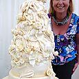3 tier satin drape Wedding Cake with ivory roses