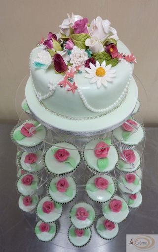 Rose Garden topper Wedding Cake with matching cup cakes