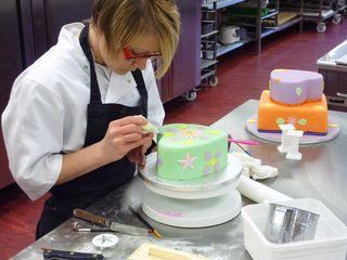 Mel icing a wedding cake