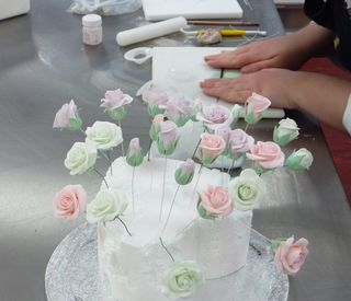 Rebecca making handmade sugar hands