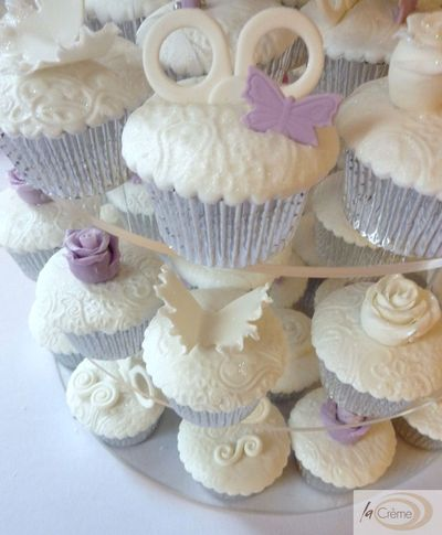 Embossed violet and white fondant cup cakes s