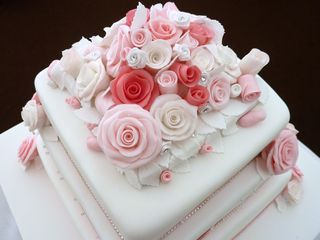 3 tier pink and white wedding cake 2s