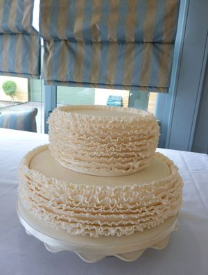 2 tier ivory ruffle wedding cake s
