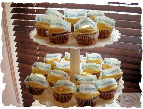 Coloplast Cup cakes displayed on a stand