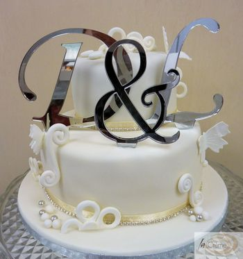 2 tier ivory wedding cake with initials