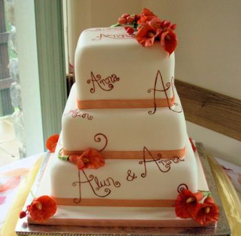 3 tier ivory wedding cake painted with names