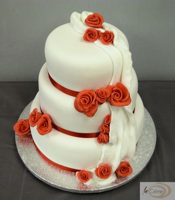 3 tier white wedding cake with red roses