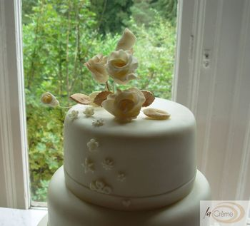 Rose topper on ivory Wedding cake
